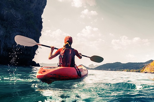 Woman kayaking. Travel services Oregonian Media Group.